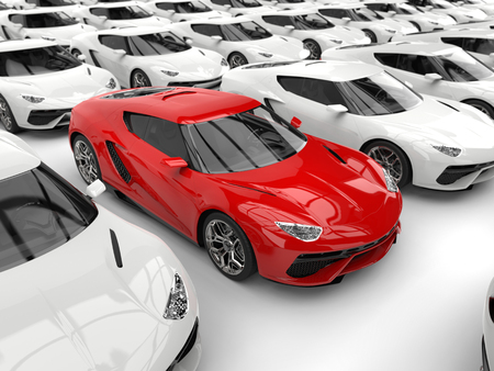 Red sports car stands out amongst white cars - closeup shot