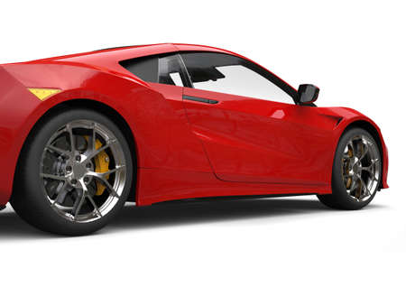 Fiery red modern luxury sports car - cut shot Stock Photo