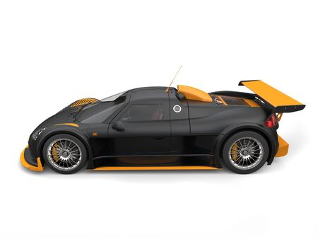 Awesome supercar in matte black paint with yellow details - side view Stock Photo