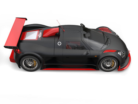 Awesome supercar in matte black paint with bright red details - side view Stock Photo