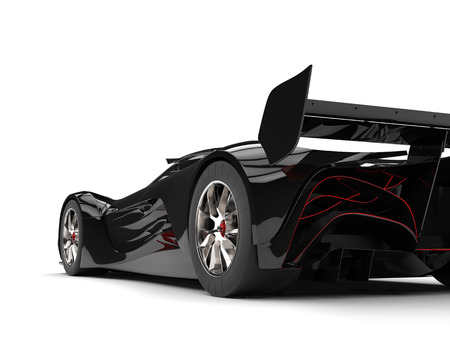 Gunmetal black racing super car with red details - rear wheel and tail closeup