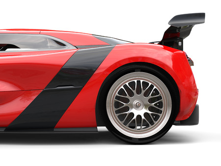 Awesome sports car - rear wheel and rear wing - cut shot
