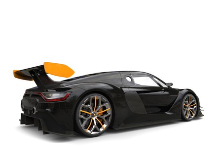 car tire: Race car - black with yellow rear wing and yellow details on the wheels Stock Photo