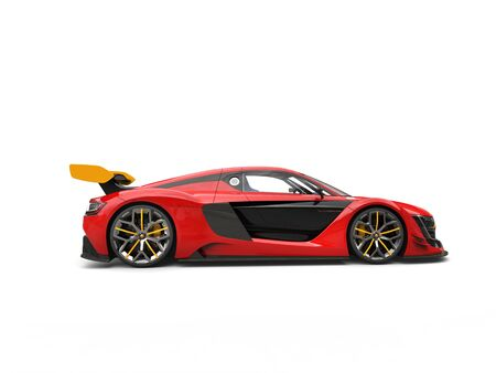 Raging red race car with yellow rear wing - side view Stock Photo