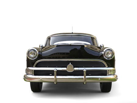 restored: Shiny black restored vintage car - front view Stock Photo