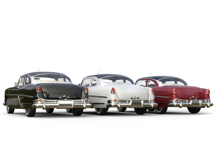 Striking vintage cars - black, white and cherry red