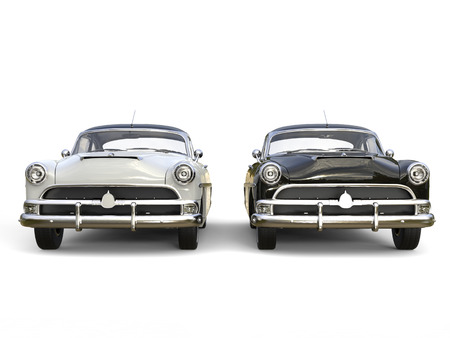 restored: Black and white awesome vintage cars - front view Stock Photo
