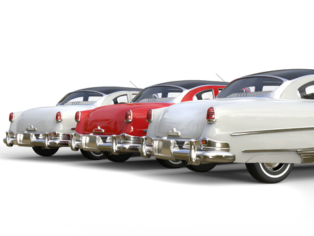 restored: Royal red vintage car stand out in between white cars - rear view Stock Photo