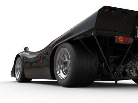 Charcoal black vintage race car - rear wheel closeup shot