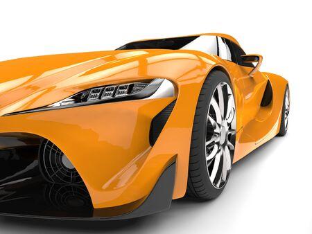Striking amber modern super car - headlight extreme closeup shot Stock Photo