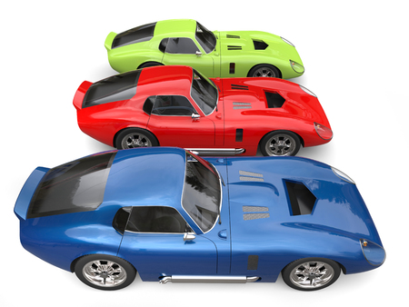 Vintage sports cars - red, green and blue - side by side