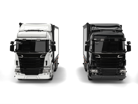 heavy industry: Black and white modern heavy transport trucks - front view Stock Photo
