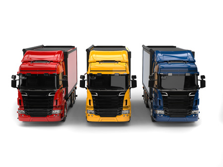 heavy industry: Heavy transport trucks - red, blue and yellow - front view