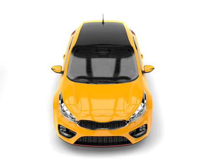 Bright yellow modern e-car - top front view Stock Photo