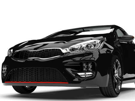 rim: Beautiful shiny midnight black modern electric car - front view extreme closeup shot