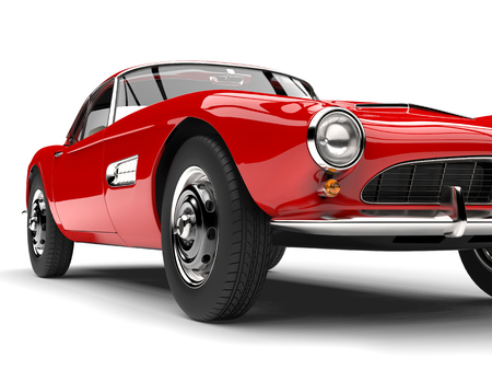 Fire red vintage sports car - front wheel closeup shot Stock Photo