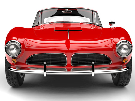 Fire red vintage sports car - front view extreme closeup shot Reklamní fotografie