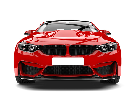 Crimson red modern sport racing car - front view closeup shot