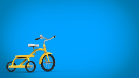 Pretty vintage yellow tricycle - blue background Stock Photo