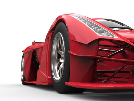 Angry red super race car - front view low angle shot
