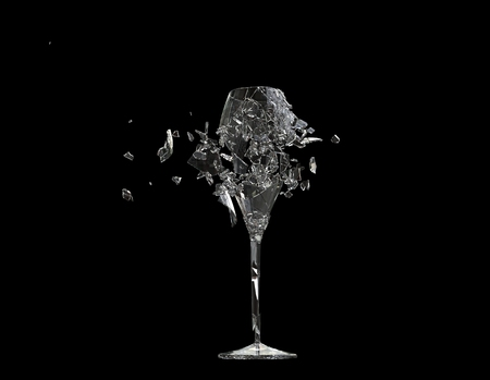 Shattered vine glass - on black background 免版税图像