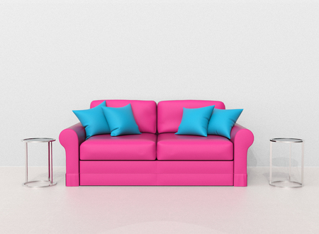 Pink sofa with light blue pillows with two end tables on the sides Stock Photo