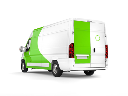 Big white delivery van with green details - rear side view Stock Photo