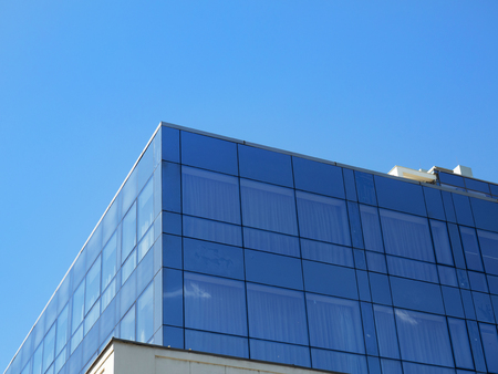 Modern business building - dark blue tinted glass windows