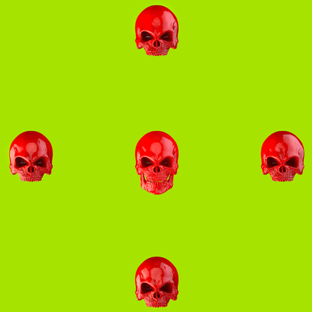 Red skulls on bright green background