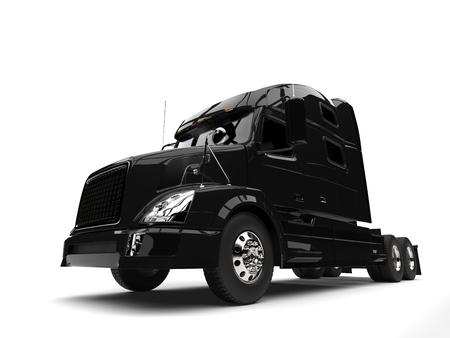 Black modern semi trailer truck - low angle shot Stock Photo