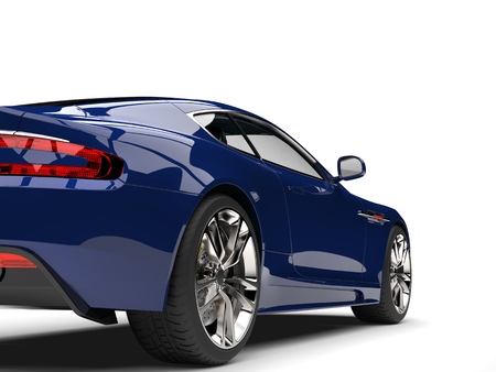 Deep blue modern luxury sports car - rear wheel closeup shot