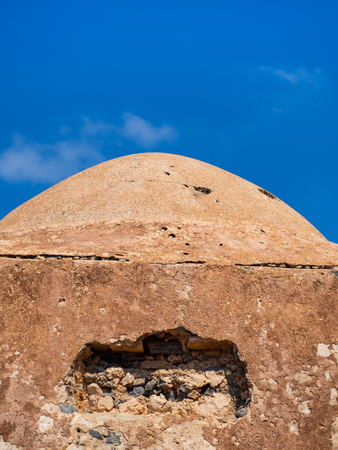 Small roof of the ancient temple ruins, blue sky background Stock Photo