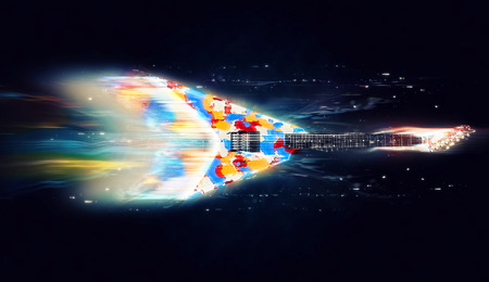 Colorful heavy metal guitar - cosmic light trails Stock Photo