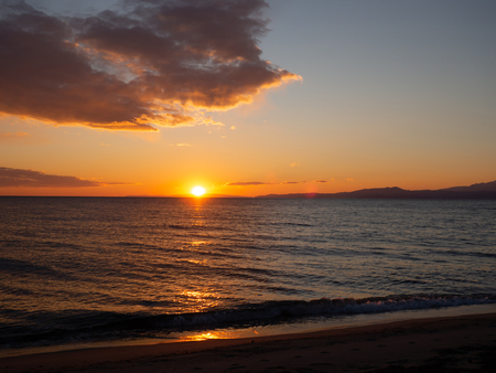 Amazing orange sunset on a beautiful empty beach