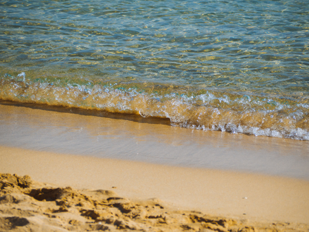 Small waves on a nice empty sandy beach - crystal clear water