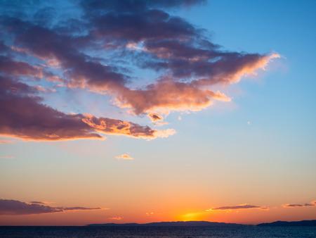 Beautiful sky and sunset - islands and mountains on the horizon 版權商用圖片
