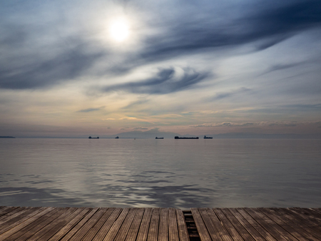Big trade and transport ships on the horizon - strange clouds in the sky 版權商用圖片