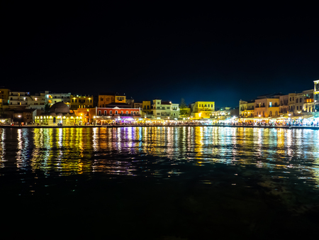 Night scene of amazing Chania port - old town by the sea - Crete, Greece