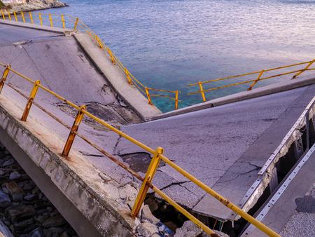 Broken and destroyed bridge near the sea