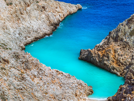 Amazing secluded beach in between zig - zag cliffs - beautiful shades of blue sea - tropical paradise