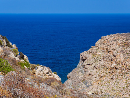 Beautiful view of the blue sea and rock cliffs Reklamní fotografie
