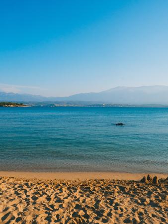 Beautiful beach - orange sand and crystal clear blue water Reklamní fotografie