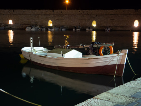 Small white boat docked at the old port