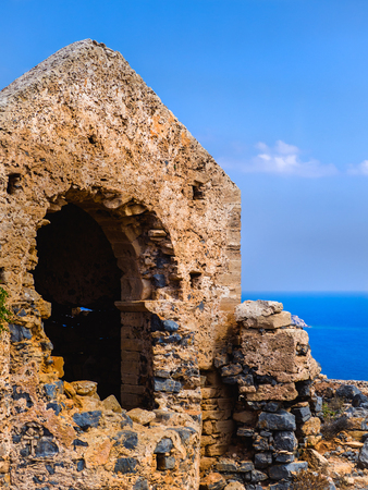Ancient temple ruins atop the hill - sea and clear skies in the background Reklamní fotografie