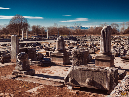 Ancient Greek ruins, stone slabs, columns and building foundations at Philippi, Greece