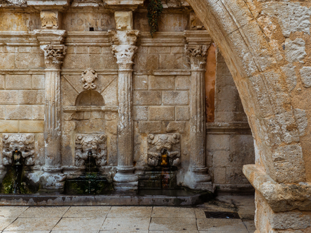 Ancient Roman stone fountain with amazing wall relief details