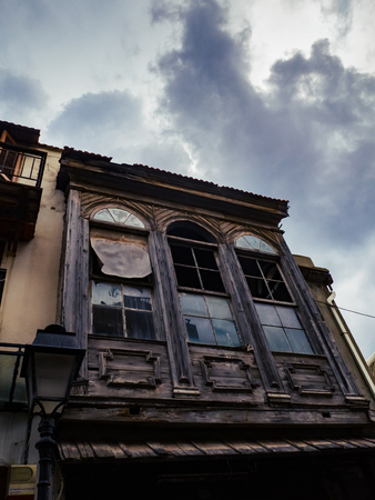 Abandoned old house in the old part of town - storm clouds looming above Reklamní fotografie