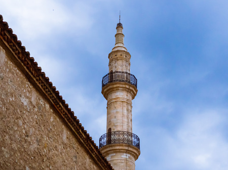 Minaret of old mosque towering over the wall in the old part of Rethymno - Crete, Greece Reklamní fotografie