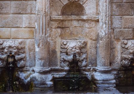 Closeup detail of the stone sculptures on a ancient Roman fountain in Rethymno city - Crete, Greece