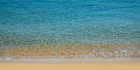 Clam and beautiful empty beach - amazing blue clear sea water and orange sand